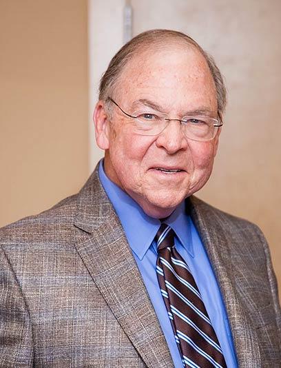 Dr. Russell E Swann